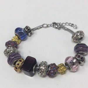Purple, blue, pink, gold, silver charm bracelet